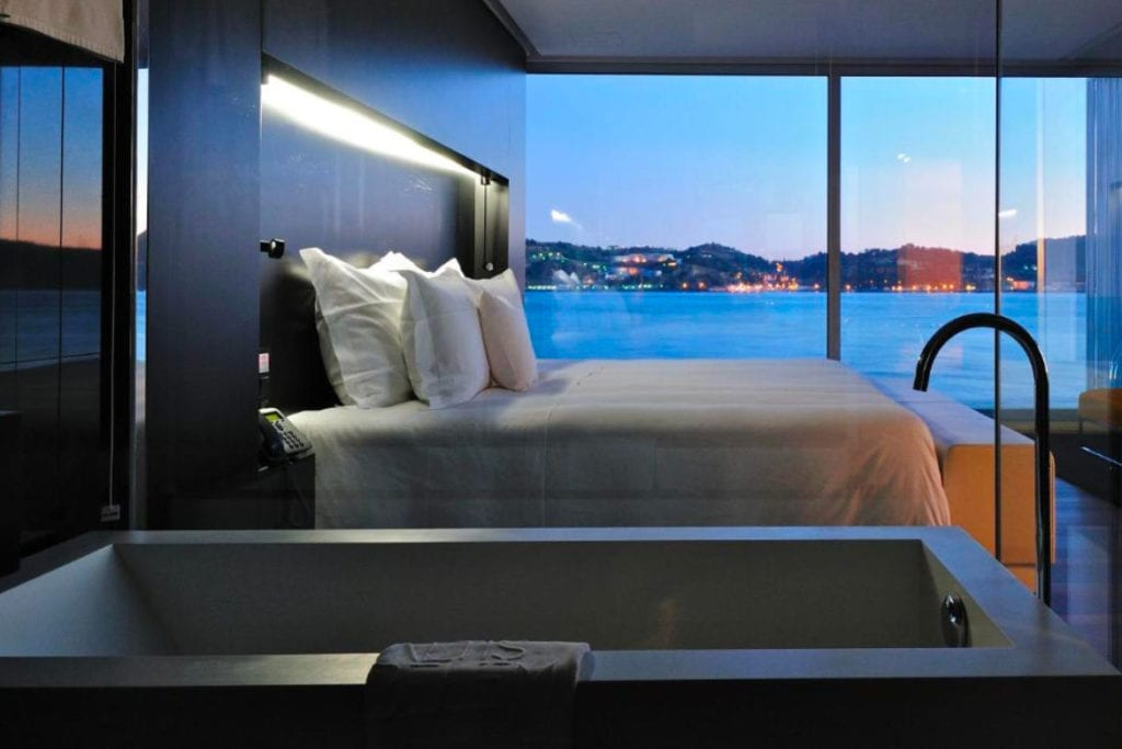 Photo of Altis Belém Hotel & SPA bedroom with a double bed and a big window with Tagus River view