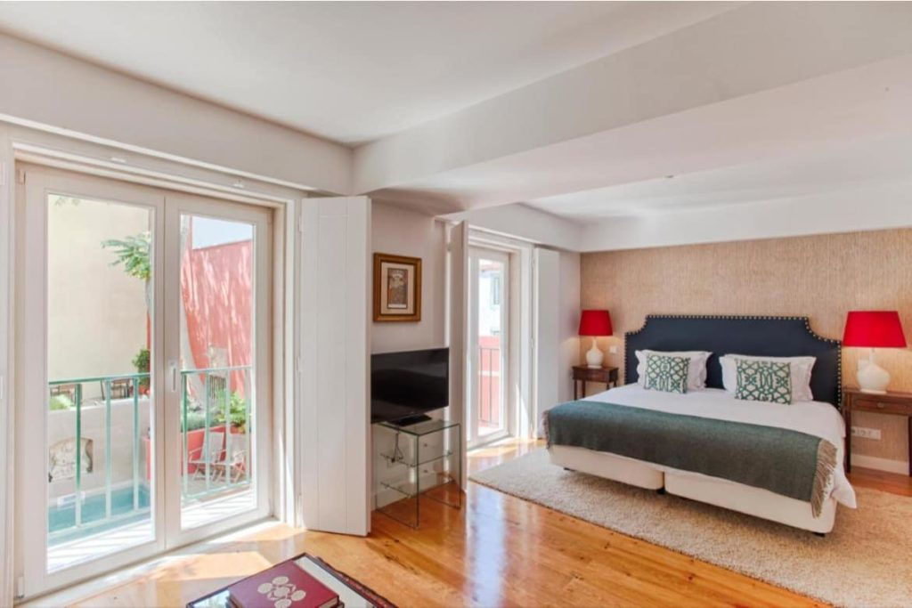 Photo of Dear Lisbon Charming House bedroom with a double bed and a balcony