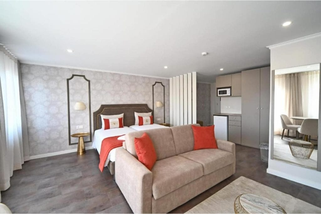 Photo of Famous Crown Suites Lisboa bedroom with a double bed and a sofa