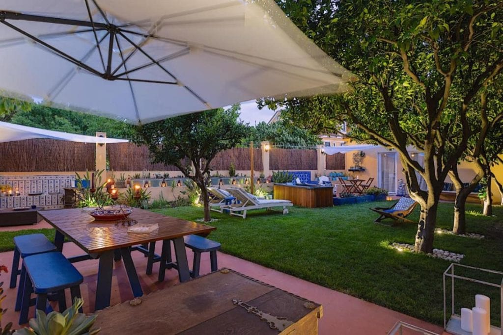 Photo of Geronimo Guest House Belém garden with different places to sit and stay