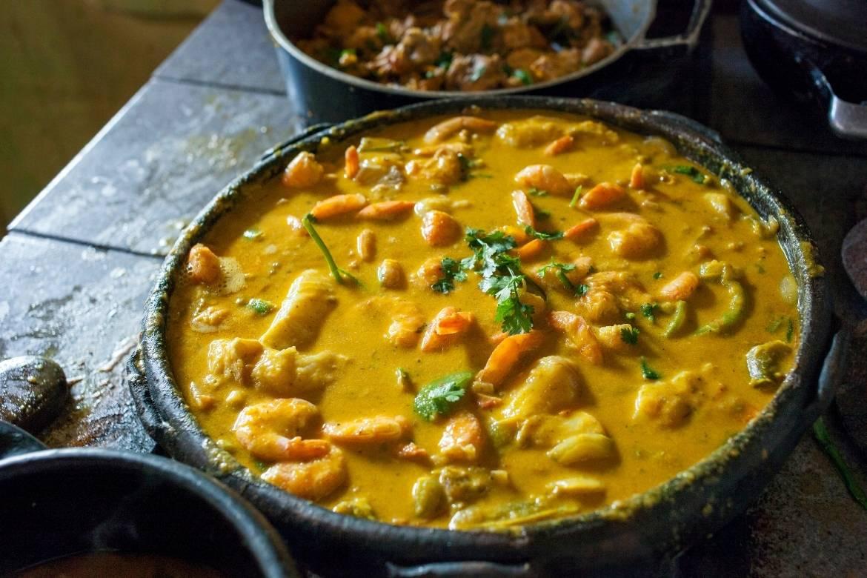Shrimp and fish Brazilian moqueca in a clay pot