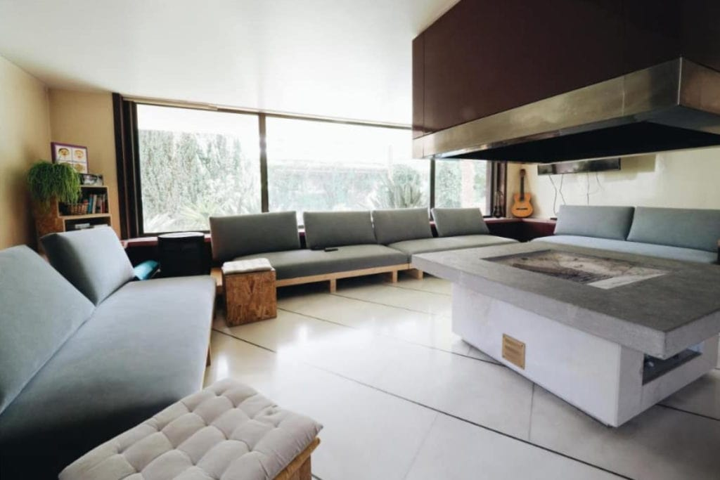 Photo of Impact House Belém living room with two sofas, a guitar and a fireplace in the middle