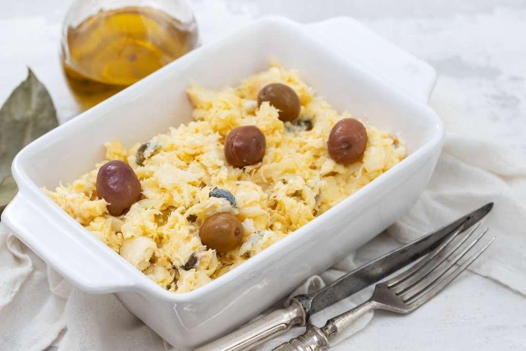 white baking tray with Bacalhau a lisboense