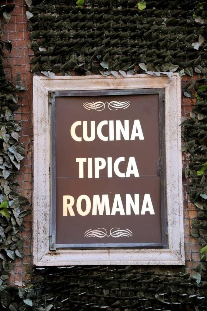 Brown sign written Cucina Tipica Romana