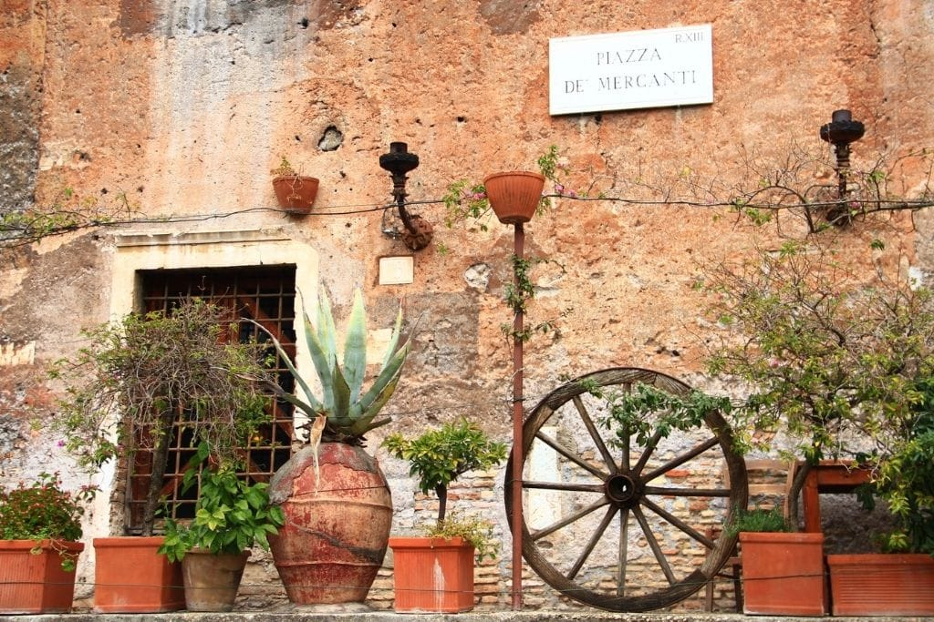 Wall with a sign of Piazza dei Mercanti in Trastevere neighborhood in Rome