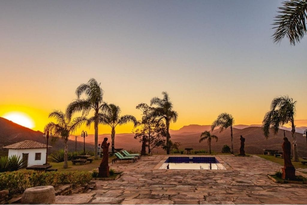 sunset view from the pool at vila relicario hotel farm hotel in minas gerais
