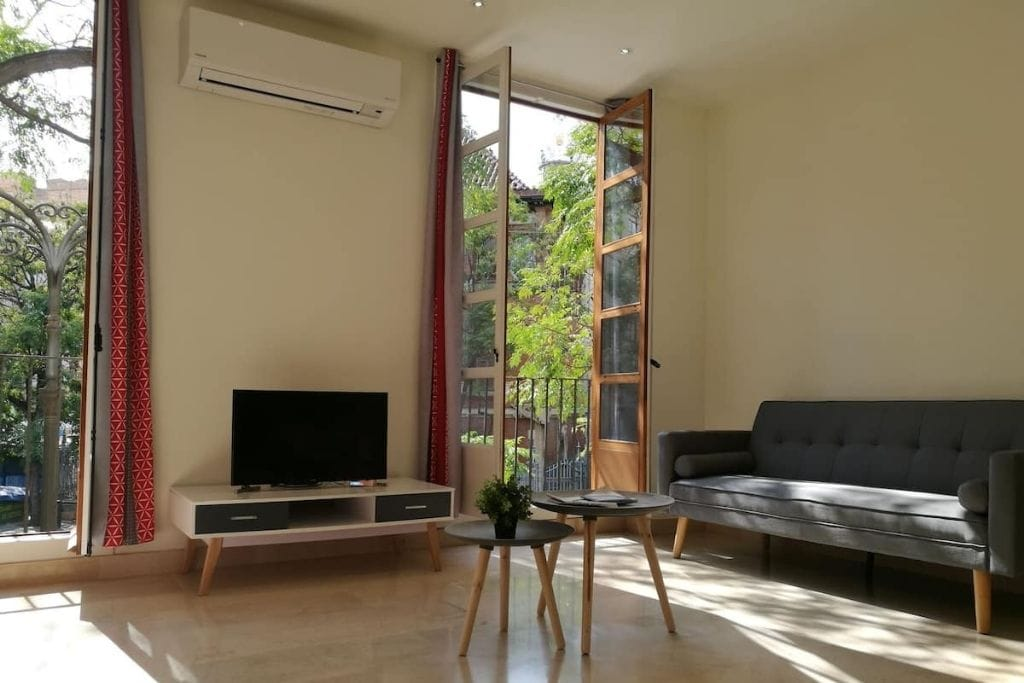 living room with balcony and open windows at private holiday airbnb in valencia