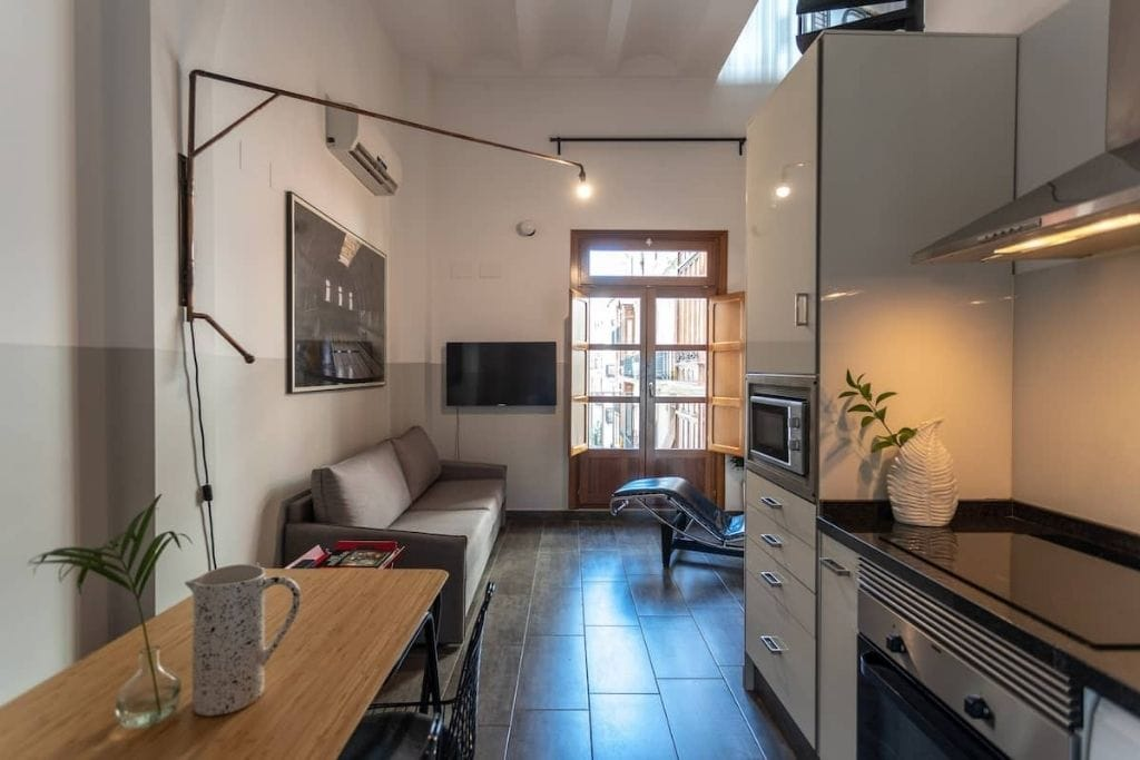 kitchenette and living room, open space, at bubuflats in valencia