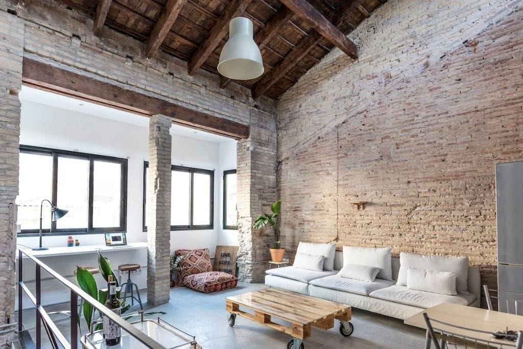 beautiful and full of light living room with industrial aspect private apartment by the beach in Valencia