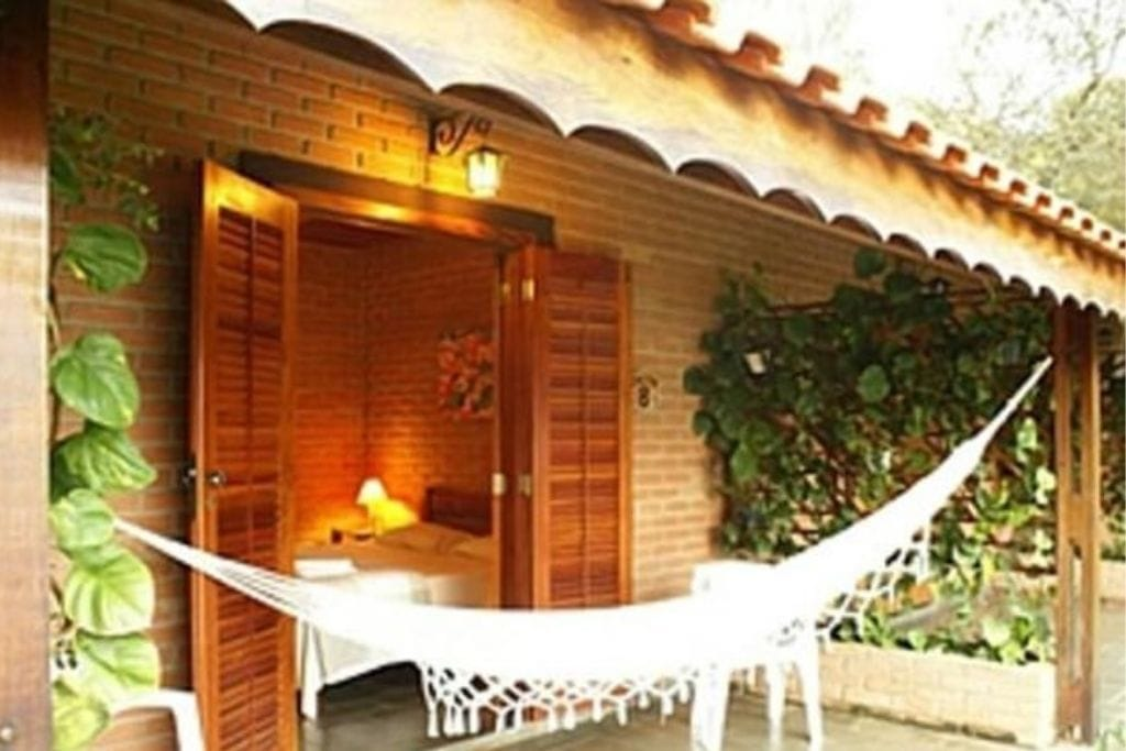 room with open doors and hammock on the terrace
